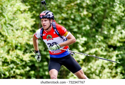Chaykovskiy, Russia - AUGUST 26, 2017: Martin Otcenas of Slovakia competes in the sprint at the IBU Summer Biathlon World Championships 2017