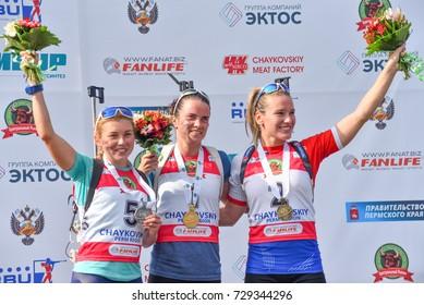 Chaykovskiy, Russia - AUGUST 27, 2017: Sleptsova of Russia, Belkina of Ukraine and Paulina Fialkova of Slovakia at the podium in the pursuit at the IBU Summer Biathlon World Championships 2017