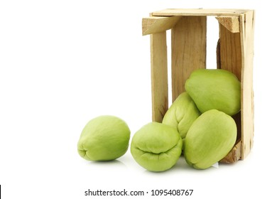 Chayote fruit (Sechium edulis)and a cut one on a white background