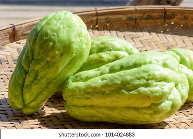 'Chayote' Sechium edule ; Image of fresh fruits. Light green thin skinny shell outer. Thick white fruit and seed inside. Crisp & sweet. Eaten like potatoes or root vegetables. natural sunlight.