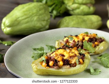 chayote stuffed baked stuffed with minced meat, corn and pieces of the chayot with cheese sauce