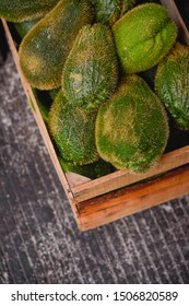 Chayotes, chayote squash in a wood box.