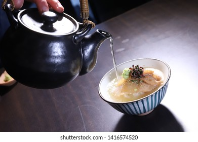 Chazuke with Dashi : a traditional japanese cuisine which is made of  rice with tea
