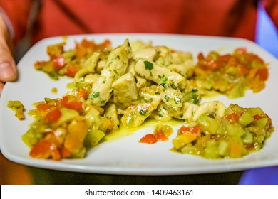 Chding dish of chicken in curry sauce with artichokes, cheese and mixed diced vegetables