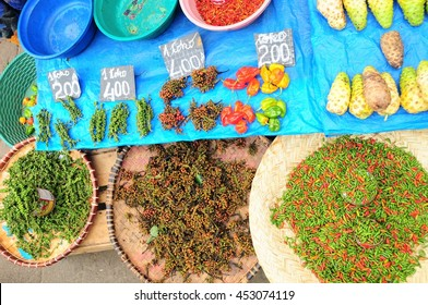 Cheap and fiery chillies and peppercorns on sale in Analakely Market, Antananarivo, Madagascar