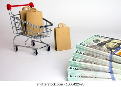 cheap and inexpensive shopping. shopping bags in  shopping cart packs of dollars, white background