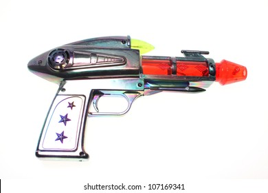 Cheap plastic ray gun isolated on white background.
