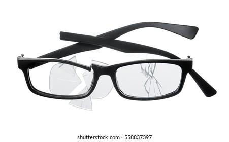 Cheap plastic reading glasses broken on white background.