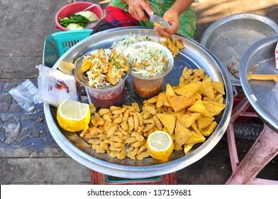 Cheap street food selling by vendors in Yangon city, Myanmar, Burma