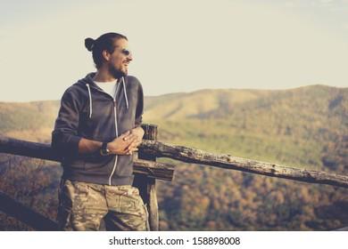 Chearful man enjoying nature view. National Park Fruska Gora, Serbia.