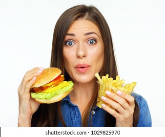 Cheat meal burger day with french fried. Portrait of happy girl holding fast food set.