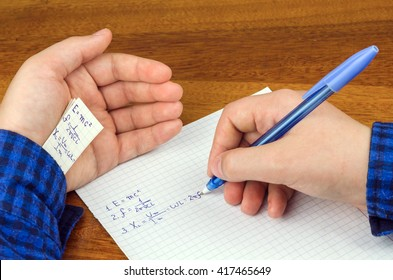 cheat sheet written in the hand a schoolboy, student