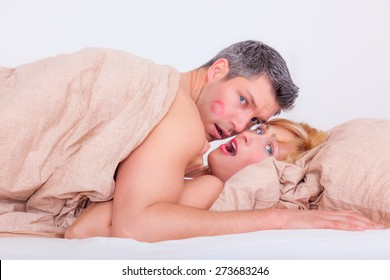 cheating lovers in hotel bed