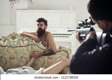 Cheating wife with lover and husband with gun. Cheating couple and gunman in bedroom.