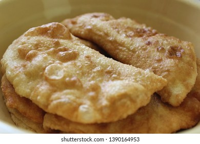 Chebureks - fried dough with meat and potatoes, Asian dish. Close-up, macro.