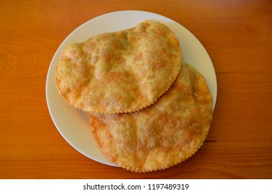 Chebureks with meat on a white plate