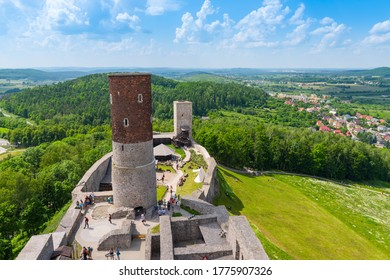 Checiny, Poland - June 13, 2020: Aerial view of 13th century Checiny Castle, ruins of medieval stronghold near Kielce city at sunny day.
