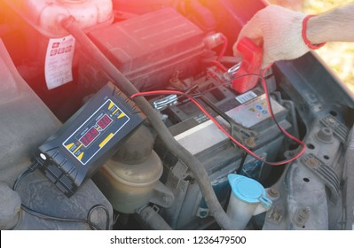 Check car battery charging with special equipment