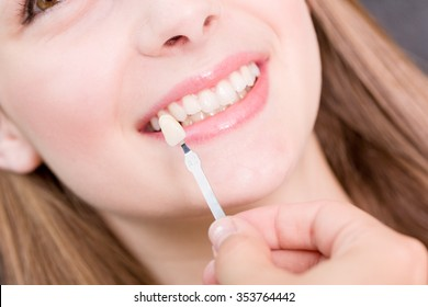 Check color of tooth crown in a dental laboratory