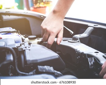 Check the condition of the car engine, repair or maintenance concept. Professional car mechanic fixing a car engine in auto repair workshop service. Selective focus.
