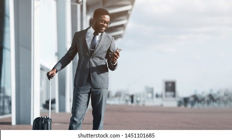 Check E-mail. Afro Businessman Arriving at Airport and Using Phone Outdoors, Copy Space