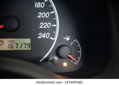 Check engine light and Oil pressure red light icon on car dashboard. fuel gauge alarm light.