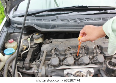 Check the engine oil level in modern car motor
