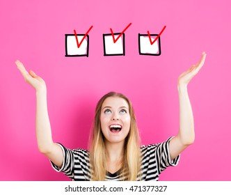 Check List concept with young woman reaching and looking upwards