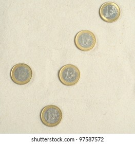 Check made ot euro coins on the sand