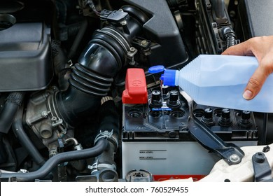 Check or maintenance car battery with distilled water