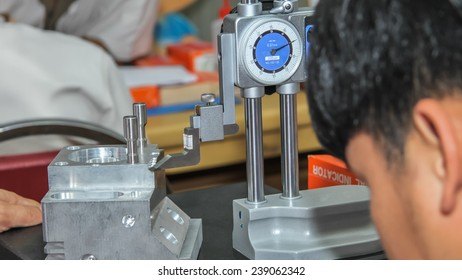 Check measurement of blank in attachment by digital hand caliper and Micrometer.metalworking industry: finishing metal working on surface grinder machine with flying sparks