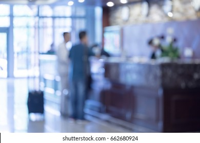 Check in and check out at Hotel reception,The blurred background of the image outside the focus