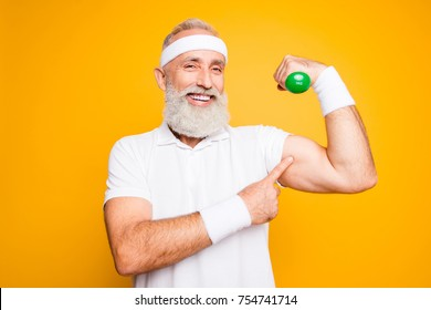 Check this out! Cheerful excited modern cool pensioner grandpa practising bodybuilding, exercising holding equipment up, lifts it with strength and power. Body care, hobby, weight loss lifestyle