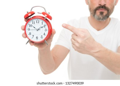 Check time. Man hold alarm clock in hand. Guy bearded mature man worry about time. What time is it. Time management and discipline. Punctuality and responsibility. Man with clock on white background.