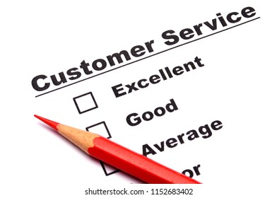 checkbox and red pen showing customer service survey or satisfaction concept to improve sales