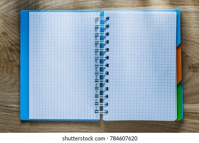 Checked copybook on wooden board.