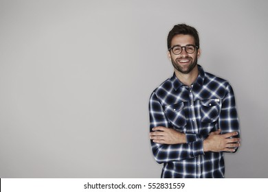 Checked guy laughing in studio, portrait