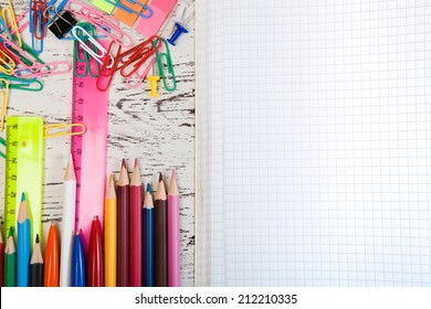 checked note paper with a pencil and paper clips