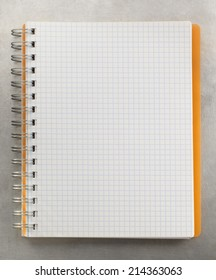 checked notebook at metal background texture