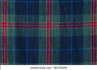 checked pattern fabric, gingham pattern in red, green and navy blue yarn.