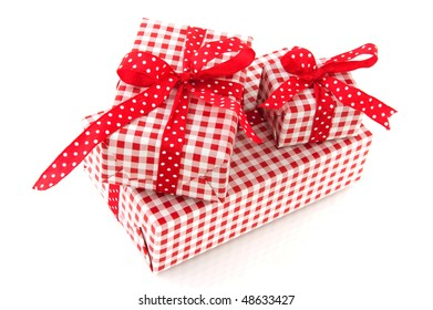 Checked presents with dotted ribbon over white background