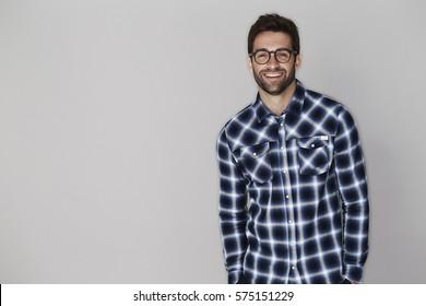 Checked shirt dude smiling at camera