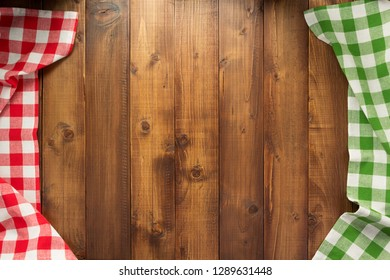 checked table cloth at wooden  surface background, top view