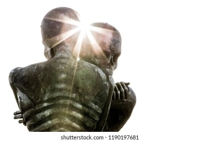 Checkendon, Oxon, England - Dec 30 2014 : The Nuba Embrace (or Nuba Survival), a statue by John Buckley