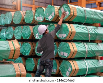 Checker is marking on package of steel pipe bundles, Inspection concept of cargo's warehouse.