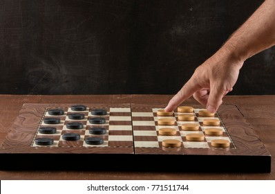 checkerboard with checkers. game concept.board game.hobby.checkers on playing field for a game