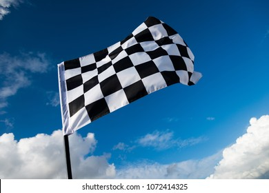 Checkered flag on blue sky