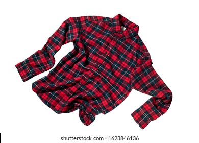 Checkered flannel shirt isolated on white. Textile wears object. Fying in air concept