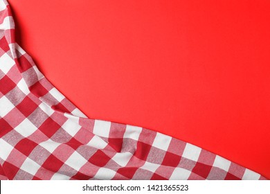 Checkered picnic blanket on color background, top view. Space for text