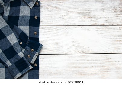 Checkered shirt on a old wooden background